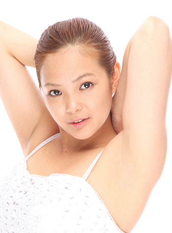 Asian woman showing underarm laser hair removal